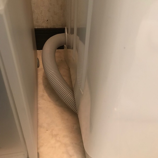 洗濯機の排水ホースにホコリや汚れがたまる問題